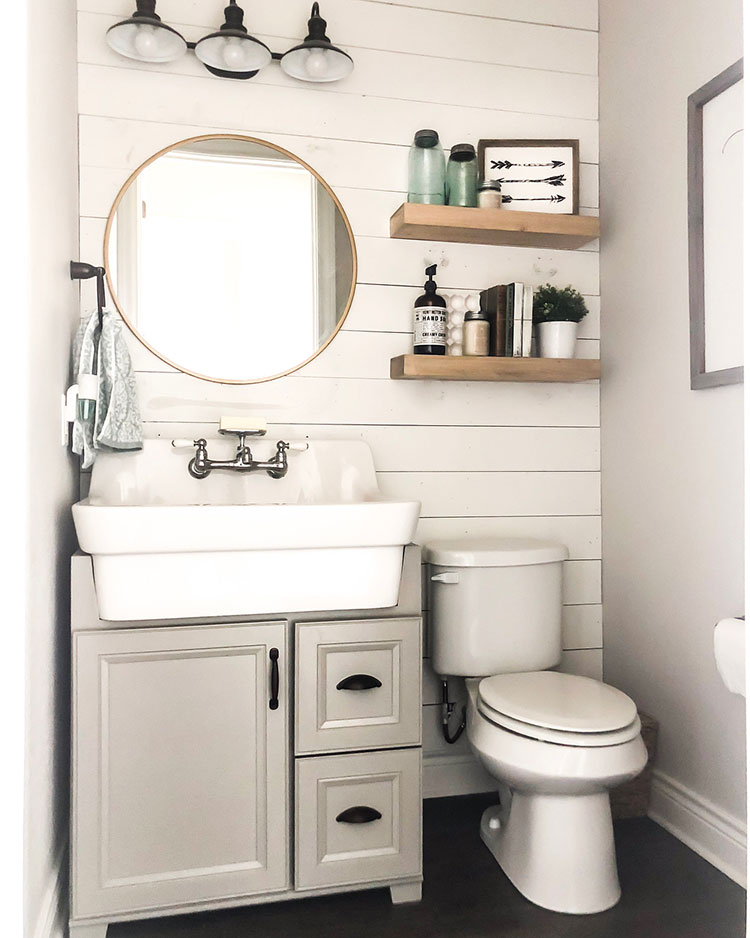 image of half bath with neutral colors and a plank wall