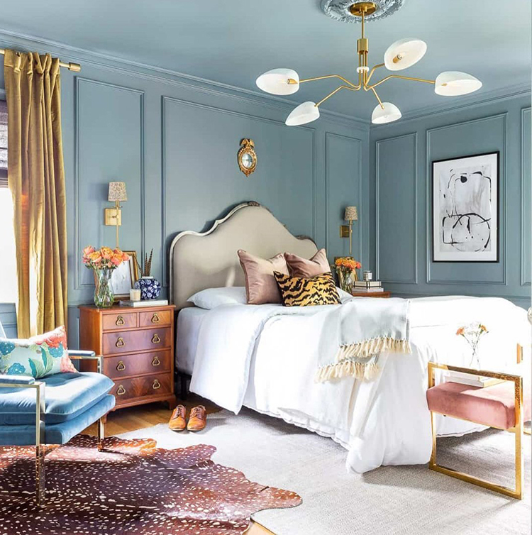 Blue monochromatic bedroom with gold accents.