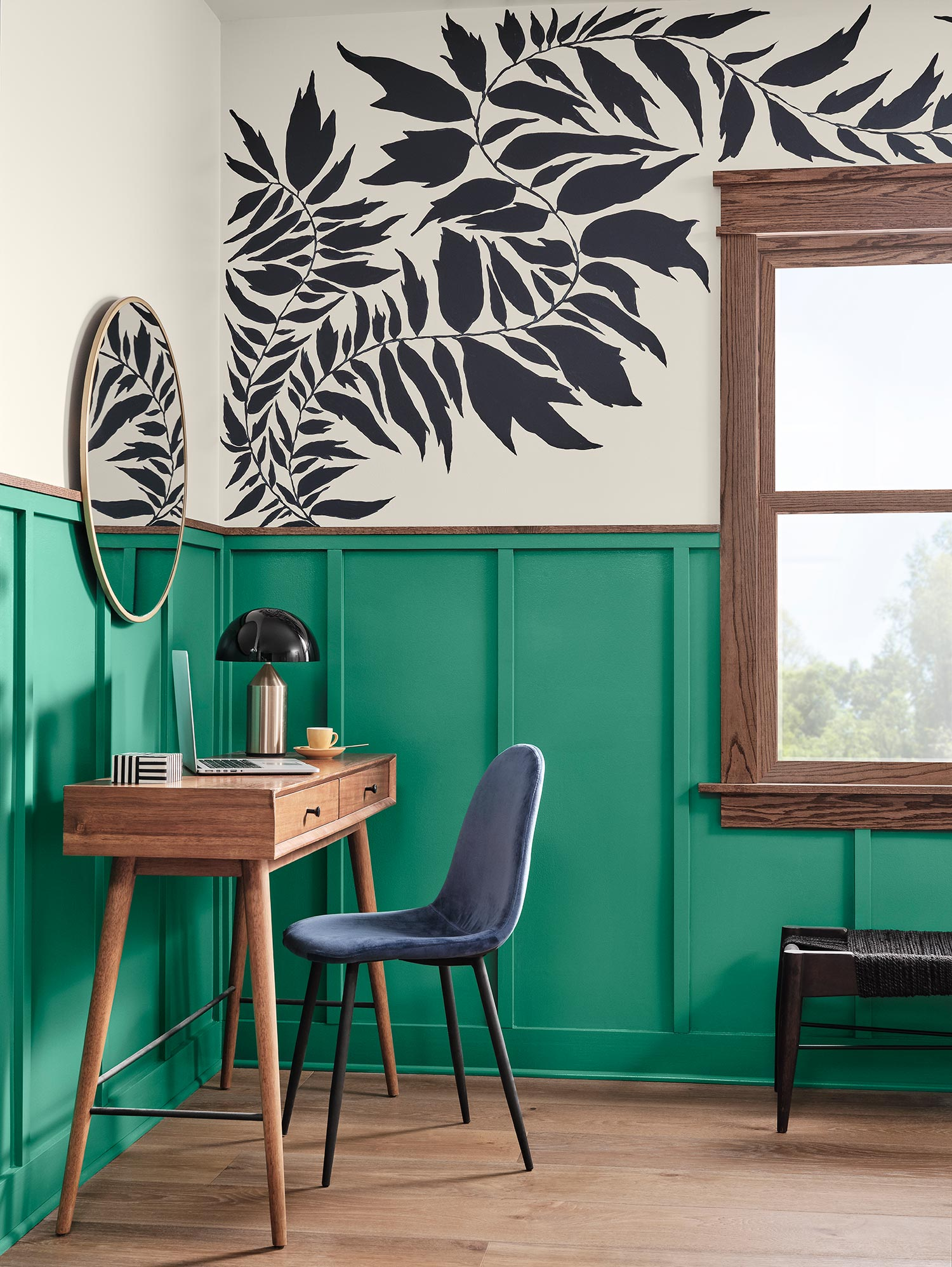 Small home office area with walls painted Alexandrite SW 0060 and hand-painted plant pattern.