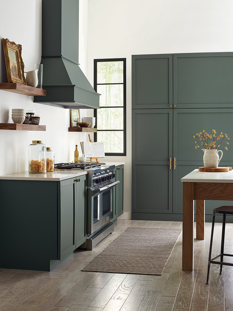 vignette of a kitchen range and cabinets.