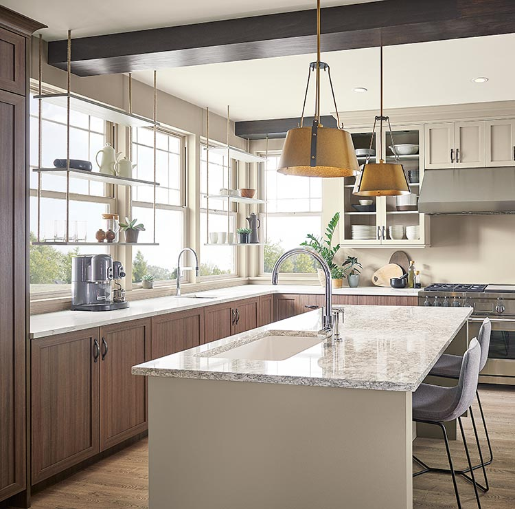 airy kitchen with island and ceiling beams
