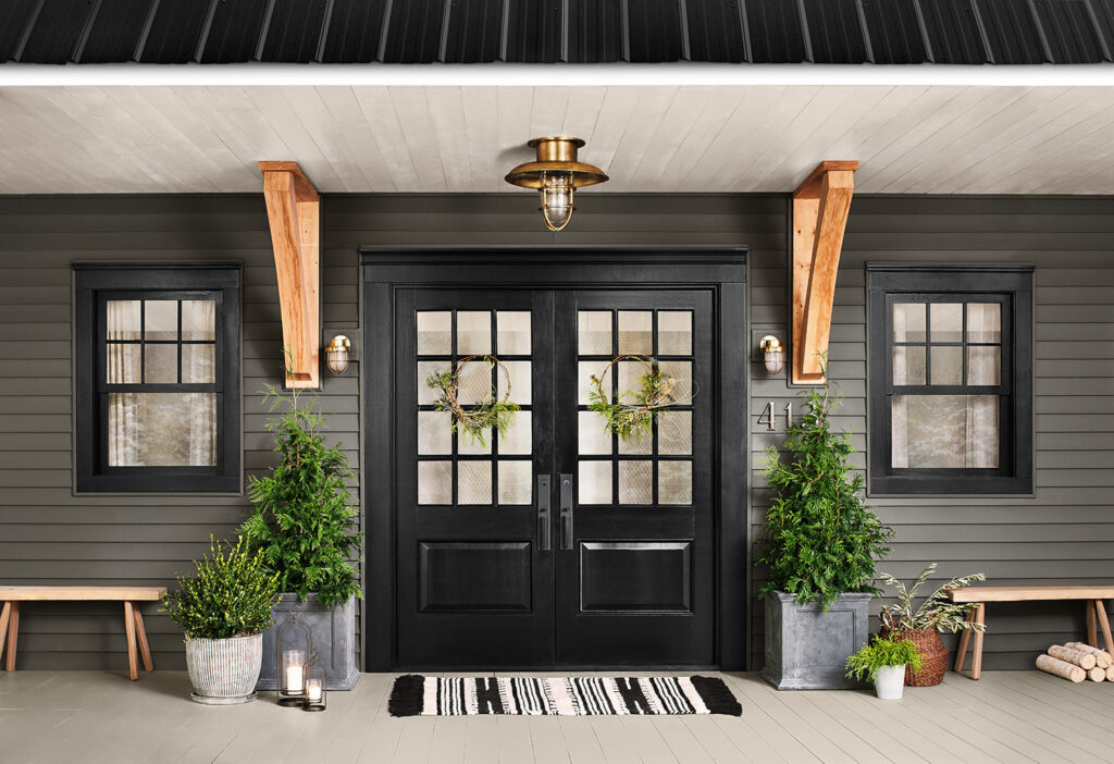 exterior shot of an entryway with double doors in black