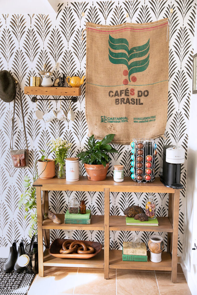 leaf stenciled wall with an area for making coffee