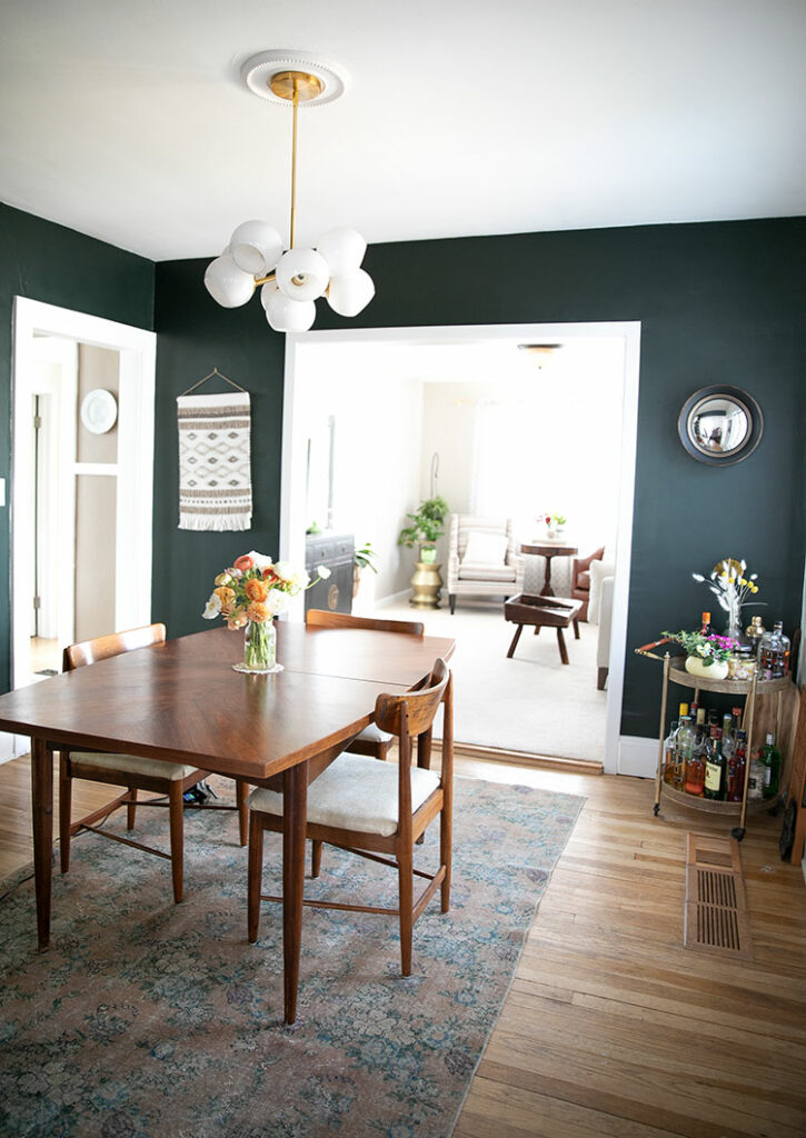 green dining room with wooden dining table