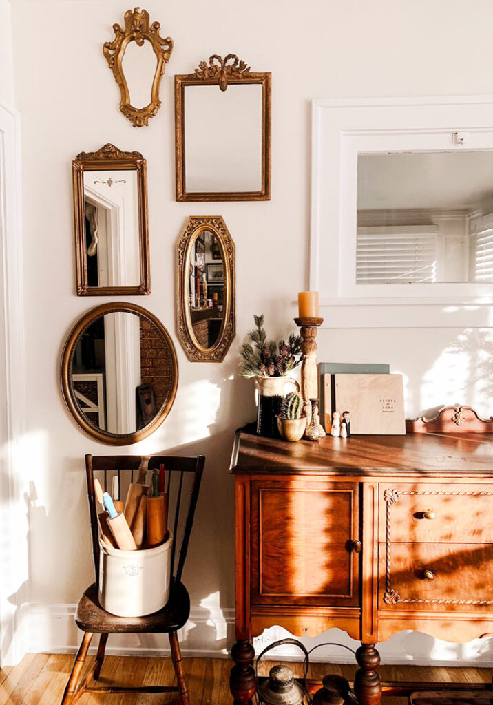 white gallery wall with collection of vintage mirrors