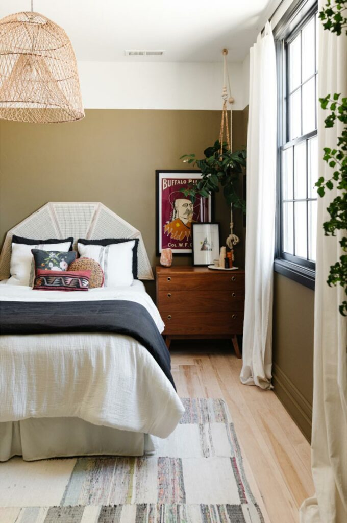Vignette of a bedroom with color blocking walls.