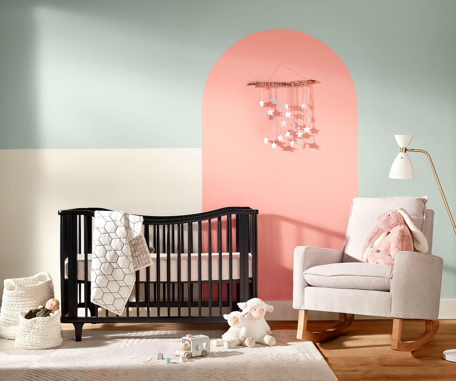 Nursery with crib and rocking chair, wall painted copen blue SW 0068 with accent arch in jovial SW 6611, and block accent in greek villa SW 7551