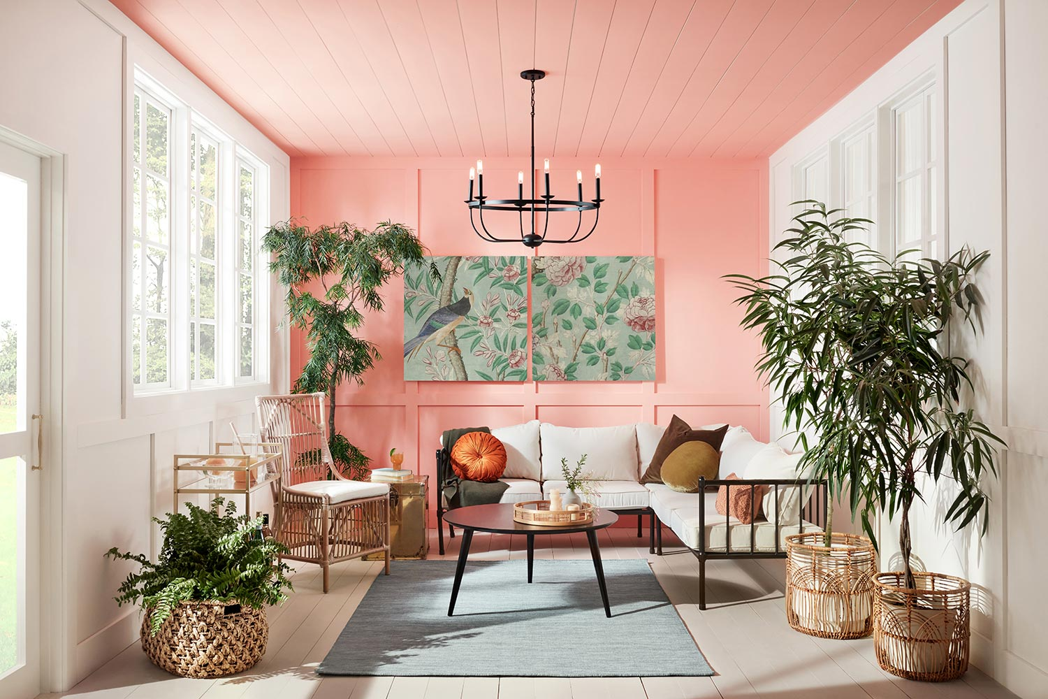 Covered porch with back wall and ceiling painted jovial SW 6611, accompanied by boho influenced decor and furniture