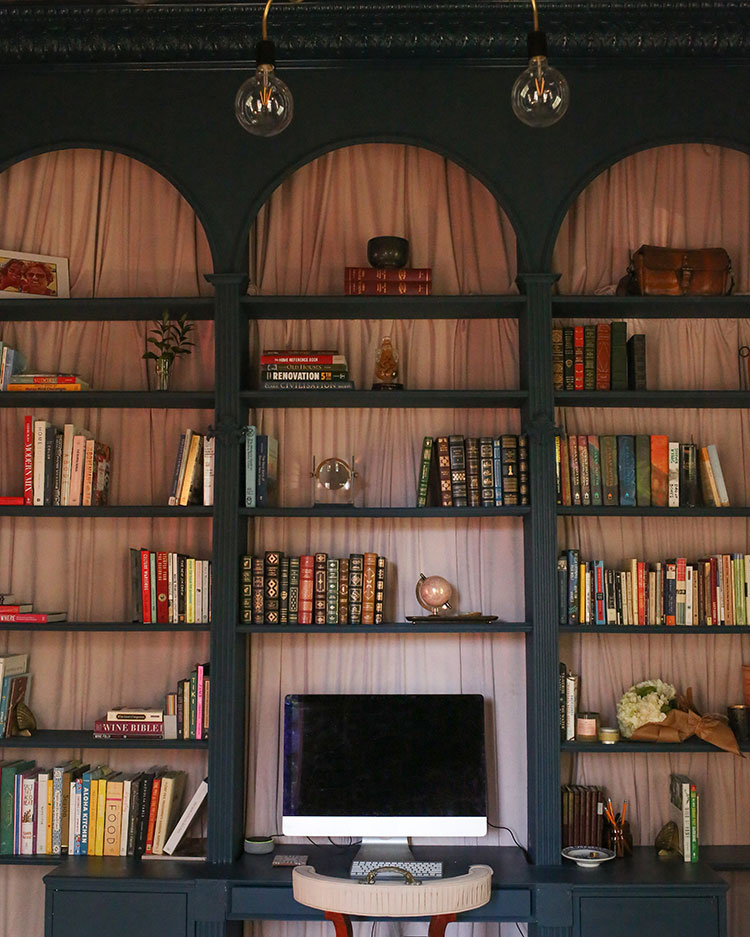 Home office with a built-in Victorian bookcase painted in Rainstorm SW 6230.