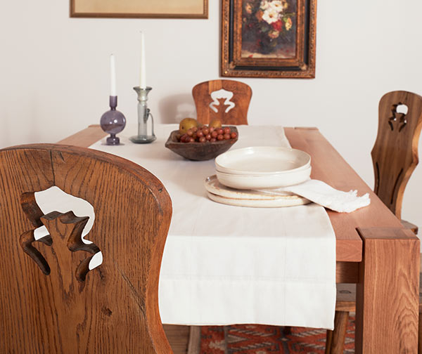 Rustic wood table with minimal rustic decoration, background walls painted Eider White SW 7014