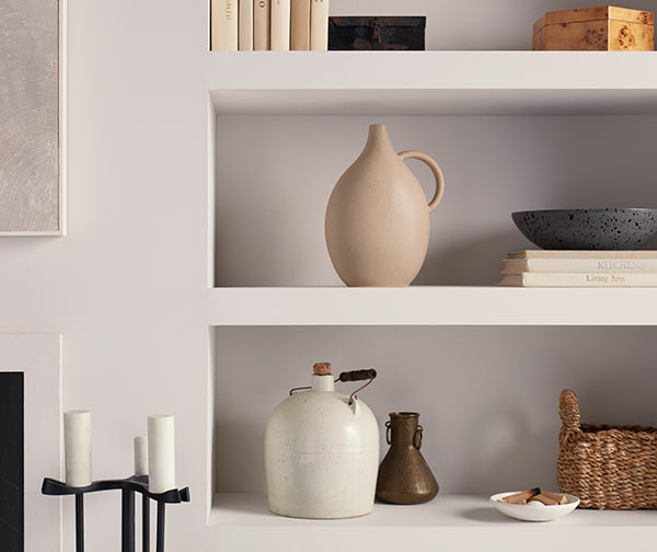 Close up of modern vases and decor in built in shelving