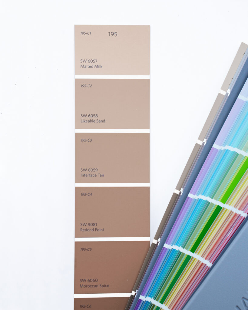 Sherwin-Williams color strip showing the light-to-dark shift in colors with red undertones starting with Malted Milk SW 6057 and ending with Moroccan Spice SW 6060.