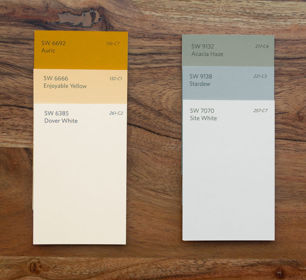 Three Sherwin-Williams color chips featuring warm colors are shown next to three Sherwin-Williams color chips featuring cool colors.