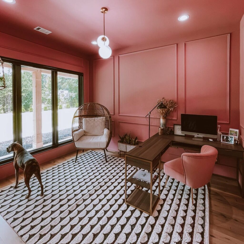 Monochromatic home office with walls, molding, trim, and ceiling painted in a bohemian coral pink color from Sherwin-Williams called Pressed Flower SW 6304.