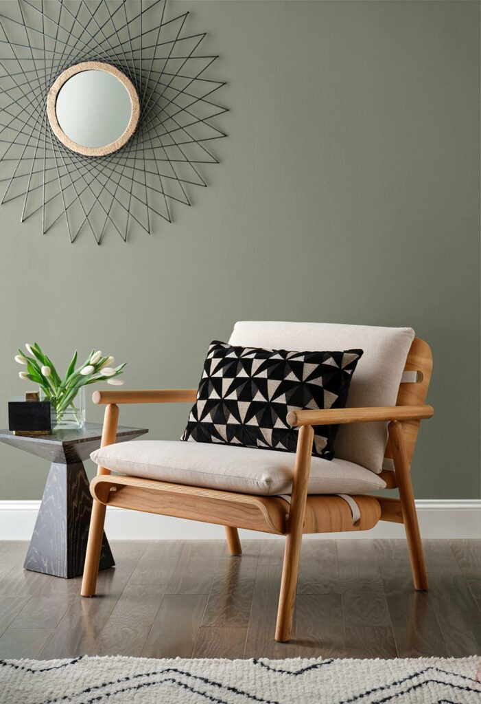 Vignette of a sitting area painted in Evergreen Fog SW 9130.
