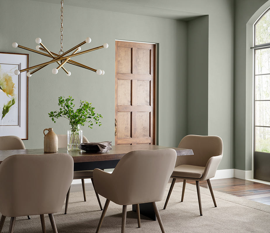 Modern dining room painted in Evergreen Fog SW 9130.