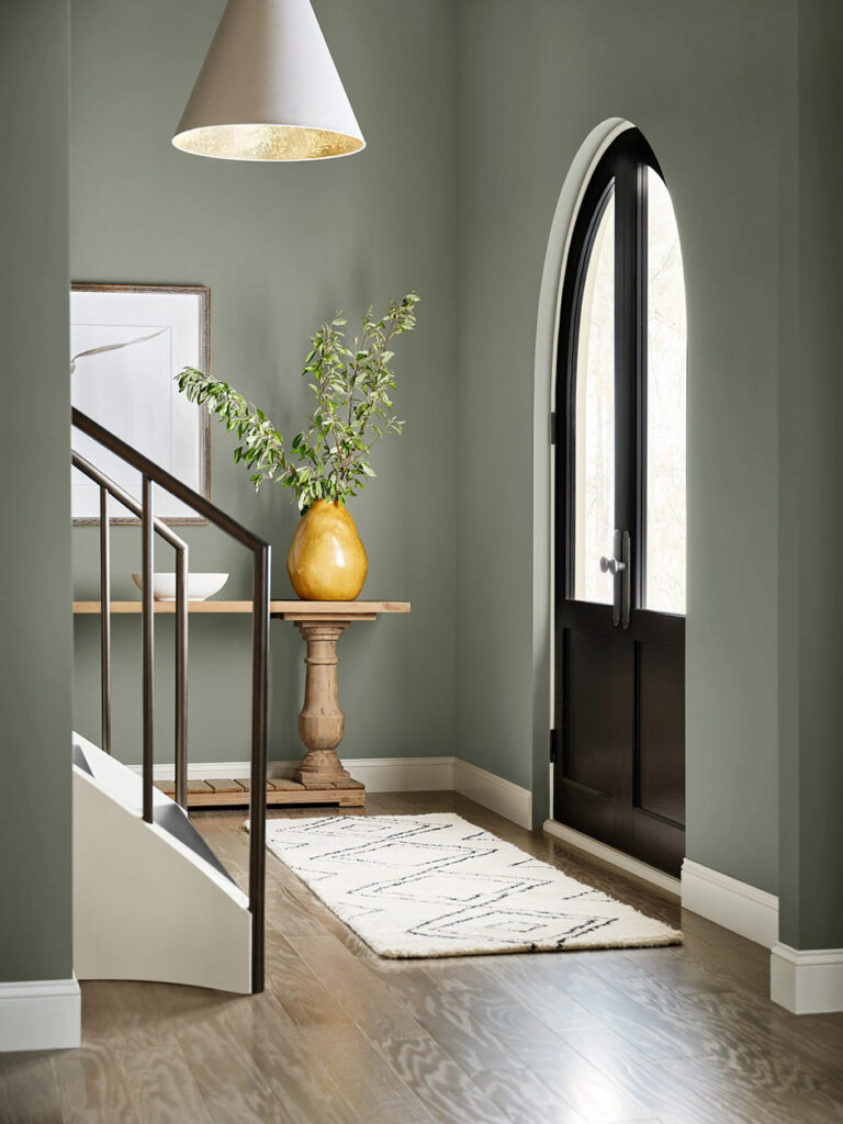 Modern entryway painted in Evergreen Fog SW 9130.