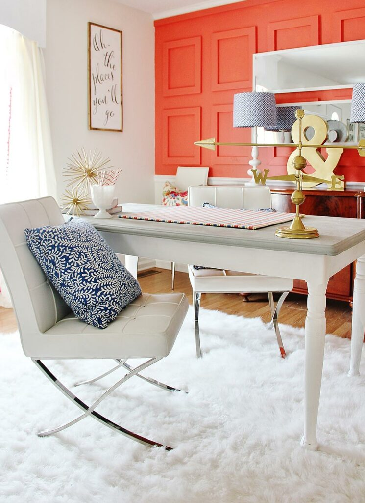 Bright home office with paneled wall painted in Coral Reef SW 6606.