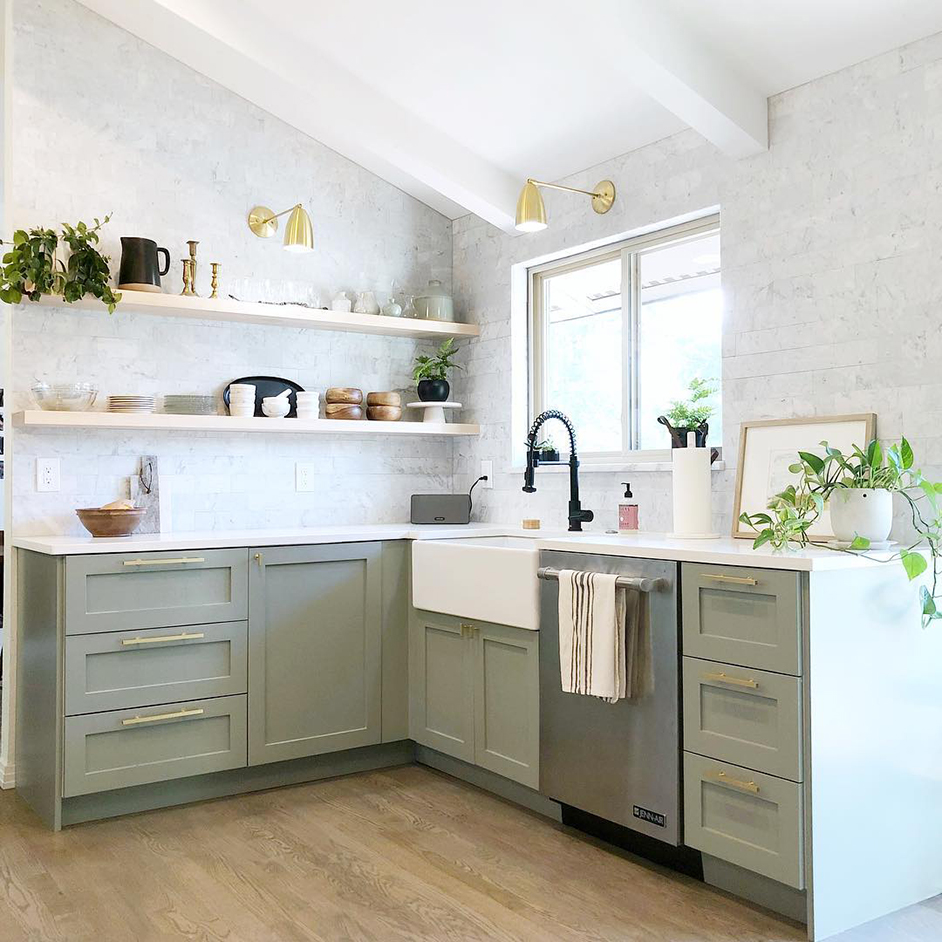Open kitchen with lower cabinets painted in Evergreen Fog SW 9130