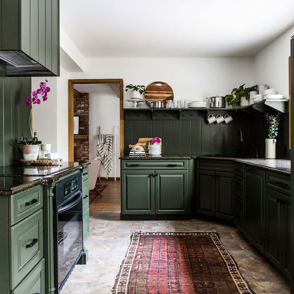Traditional kitchen with cabinets painted in Ripe Olive SW 6209.
