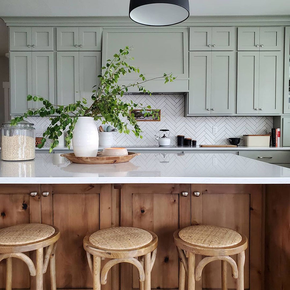 Modern kitchen with upper cabinets painted in Sensible Hue SW 6198.