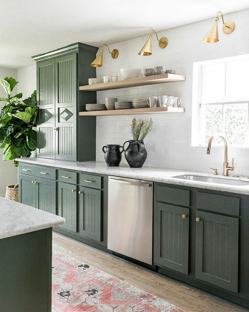 Modern kitchen with lower and upper cabinets painted in Pewter Green SW 6208.